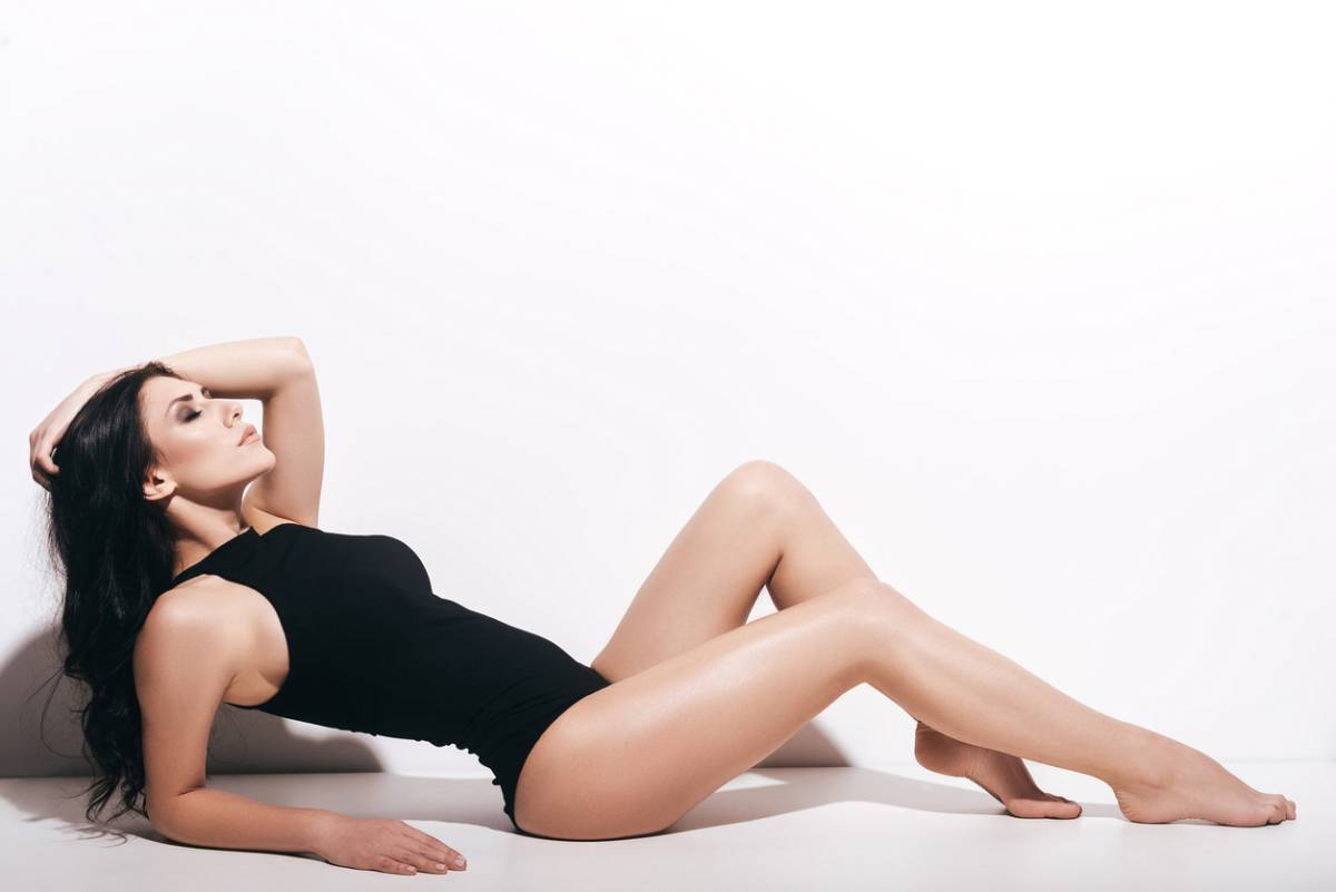 Attractive woman who has the benefits of a countoured figure wearing black body suit.