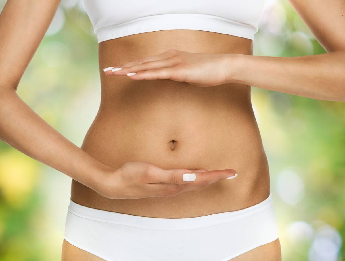 woman showing off her belly button with no problems.
