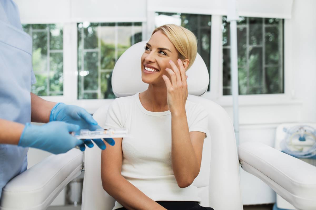 Woman working on her plan early for plastic surgery at a consultation.